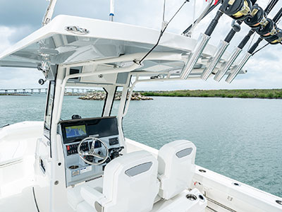 Detail view of S 268 oversized hardtop, rod holders and helm with Garmin electronics.
