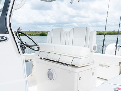 Detail view of S 268 Sport boat Helm Seating with bolsters up.