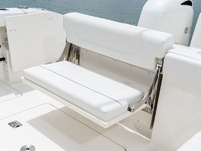 Detail of S 268 Sport center console boat fold-away transom seating.