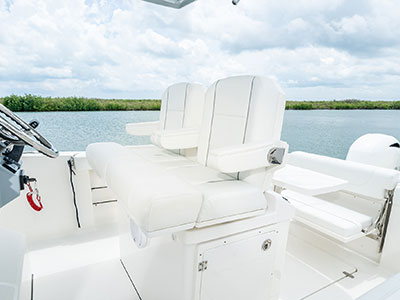 Detail view of S 268 Sport center console boat  helm seating with bolsters.