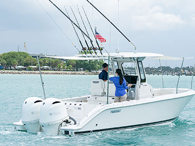 Rear one quarter view of white S 268 trolling right with Bow and Aft Med-Style Sunshade extended and twin Yamaha outboard engines.