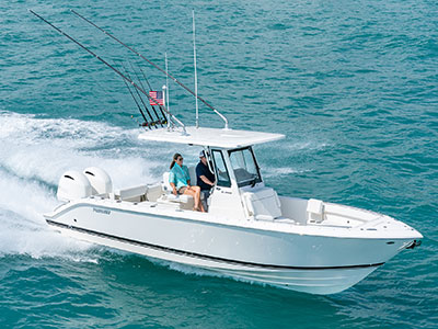 Aerial profile view of S 268 Sport center console boat running right with twin Yamaha outboard engines.