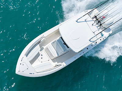Aerial overhead view of white S 268 running left with oversized fiberglass hardtop and bow seating and storage.