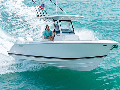 Profile view of white S 268 cruising right with fishing rods.