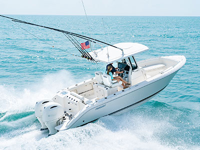 Aerial rear one quarter view of whit S 268 center console Sport boat running right with outboard engines.