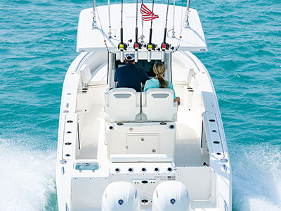 Aerial rear view of white S 268 Sport center console with rod holders and outboard engines.