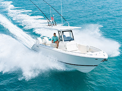 Aerial front one quarter view of white S 268 Sport boat.