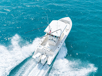 Aerial rear overhead of white S 268 Sport boat with oversized fiberglass hardtop and twin outboard engines.