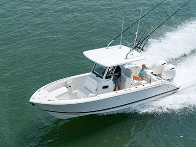 Aerial profile view of white S 268 Sport boat running left with transom seat folded down.