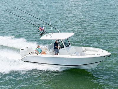 Aerial profile view of white S 268 Sport center console boat cruising right with fold-away transom seat in use.