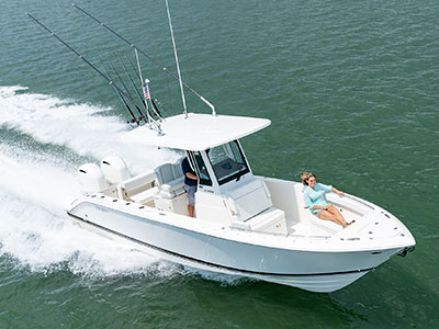 Aerial one quarter profile white S 268 Sport Center Console running right with bow seating.