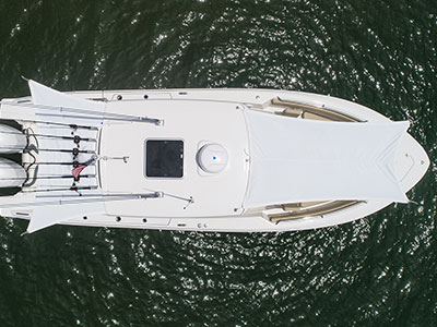 Aerial view looking down on S 288 Sport boat with forward and aft sunshades open.