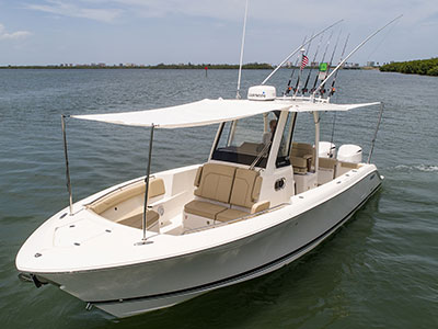 Three quarter front view of S 288 Sport boat with forward and aft sunshades open.