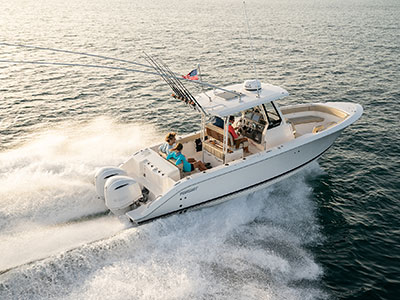Aerial one quarter profile view of the S 288 Sport boat running right.