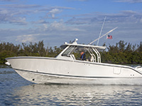 Profile view of S 328 Sport boat facing left.