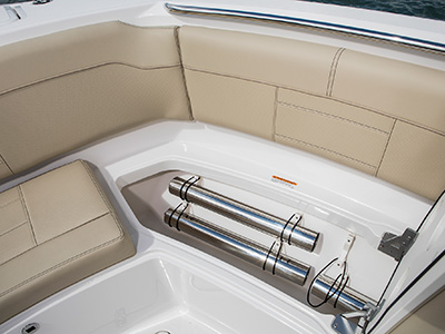 S 328 Sport boat starboard side bow storage open with fiberglass table poles.