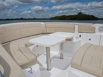 S 328 Sport boat cockpit social area with two custom fiberglass tables.