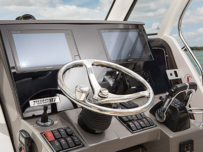 S 328 detail shot of command console helm with steering and controls