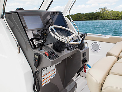 S 328 Sport boat detail shot of command console with steering and controls.