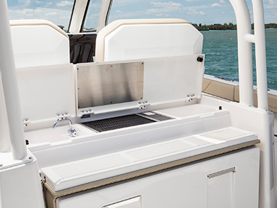 S 328 Sport boat molded entertainment center with sink, fresh water faucet, insulated FRP cooler with corian lid and drink holders(2).