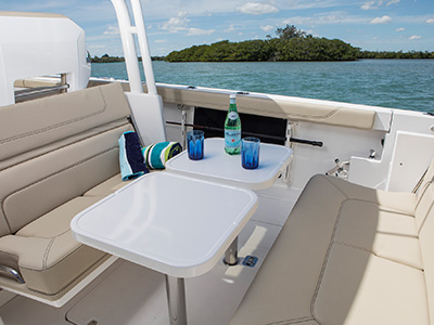 S 328 Sport boat cockpit social zone with seats open and tables.