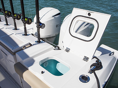 S 328 transom with rod holders, and recirculating live well with fiberglass lid