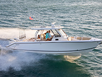 Aerial profile of S 328 Sport boat running right.