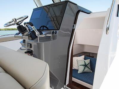 S 328 Sport boat helm with door to cabin open.