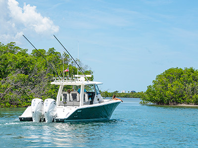 The S 358 Center Console Sport Pursuit Boat idles in Ft. Pierce waters.