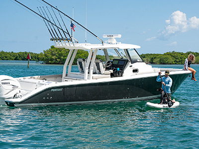 A family boat, the image shows Pursuit Boats S 358 Center Console boat with people enjoying the boating lifestyle.