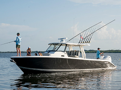 People fishing on the Pursuit Boat S 358 Sport Center Console fishing boat.