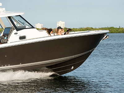 A Pursuit Boat S 358 Sport Center Console boat runs in the Indian River lagoon.