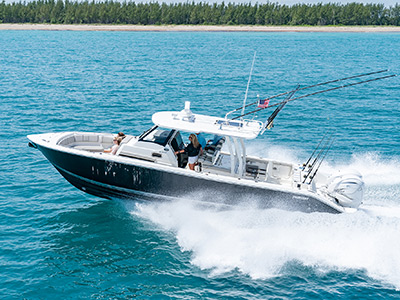 Pursuit Boats S 358 Sport Center Console Boat running left in saltwater.
