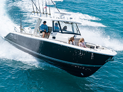 People enjoying the boating lifestyle om Pursuit Boats S 358 Sport Center Console Boat running offshore.