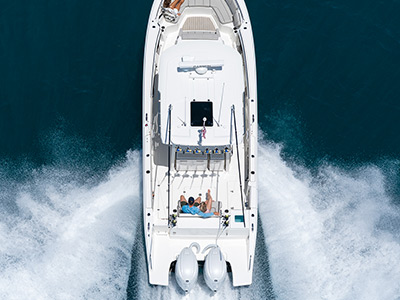 An aerial view of  Pursuit Boats S 358 Sport Center Console Boat running right in saltwater with twin Yamaha engines.
