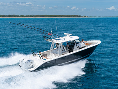 A side view of  Pursuit Boats S 358 Sport Center Console Boat running right in saltwater with twin Yamaha engines.