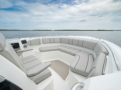 The bow of a Pursuit Boat S 358 Sport Center Console boat with lounge seating.