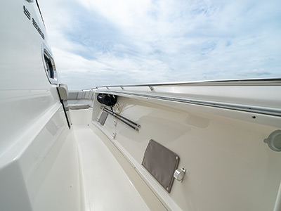 Walkway with handrails on a Pursuit Boat S 358 Sport Center Console boat.