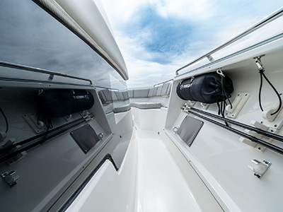 Hull side window and storage on a Pursuit Boat S 358 Sport Center Console boat.