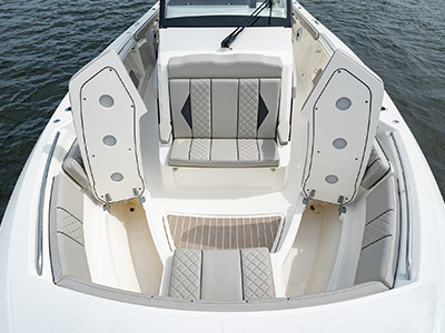 Seats on bow open for storage compartments on Pursuit Boat's S 358 Sport Center Console boat.