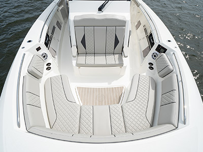 Seats on bow closed house storage compartments on Pursuit Boat's S 358 Sport Center Console boat.