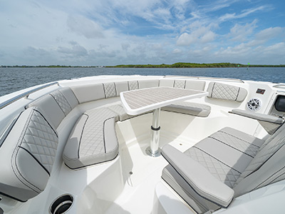 Bow view with table up on Pursuit Boat's S 358 Sport Center Console boat.
