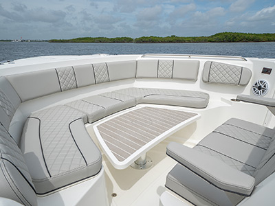Bow view with table as foot rest for sunpad on Pursuit Boat's S 358 Sport Center Console boat.