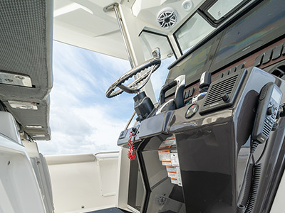 The helm of Pursuit Boat's S 358 Sport Center Console boat with Garmin electronics.
