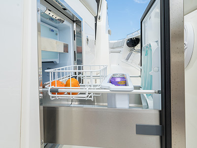 A refrigerator open is part of the entertainment center of the S 358 Sport Center Console boat.