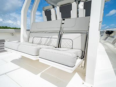 Split mezzanine seats open on the Pursuit S 358 Sport Center Console boat.
