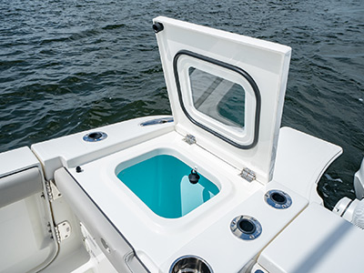 Livewell open on the Pursuit S 358 Sport Center Console boat.