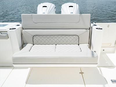 Transom seating folded down on the Pursuit S 358 Sport Center Console boat.