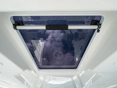 Sliding access to the oversized hardtop on the Pursuit S 358 Sport Center Console boat.