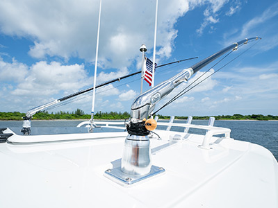 Taco outriggers on the oversized hardtop of the Pursuit S 358 Sport Center Console boat.